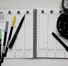 open planner with pens